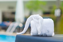Towels in form of elephants on sunbed at luxury swimming pool Stock Images