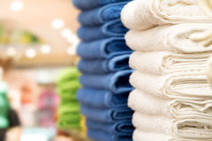 Towels. Fresh and clean towels in a store with selective focus and copy space to the left Stock Image