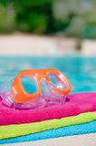 Towels and goggles near the swimming pool Royalty Free Stock Images