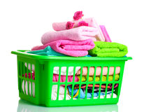 Towels in green plastic basket Stock Image
