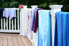 Towels grying on porch patio Stock Photography