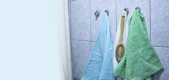 Towels hang in the bathroom on the hook royalty free stock photos