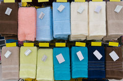 Towels Hang on Shelf in Supermarket or Hypermarket with Blank Ta Royalty Free Stock Images