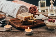Towels, homemade soap, spa treatment and candles. On wooden tabletop stock image