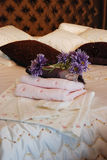 Towels in Hotel Room... Folded towels ready for use set out on a hotel room bed Royalty Free Stock Photography