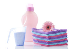 Towels and laundry detergent isolated on white Stock Photography