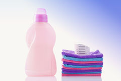 Towels and laundry detergent isolated on white Stock Images