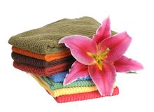 Towels and lily Stock Photos