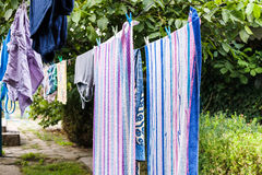 Towels and linen drying in the courtyard Royalty Free Stock Photos
