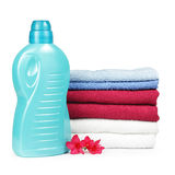 Towels and liquid laundry detergent Stock Photos