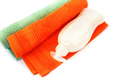 Towels and liquid soap bottle Stock Photography