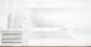 Towels on marble table in bathroom. Panorama shot : Towels on marble top table with copy space on blurred bathroom background. For product display montage stock image