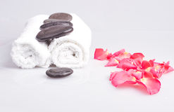 Towels and massage stones Royalty Free Stock Images
