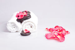 Towels and massage stones. On a white background stock photography