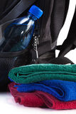 Towels for men. Towels, bottle and backpack on white background Royalty Free Stock Photo
