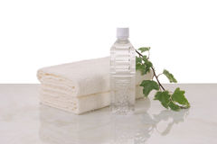 Towels and mineral water  Royalty Free Stock Photography