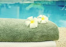 Towels near the pool. Spa towels near the swimming pool Stock Images