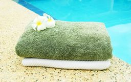 Towels near the pool. Spa towels near the swimming pool Stock Image