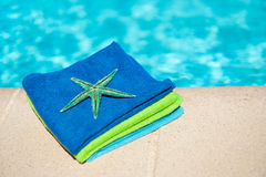 Towels near the swimming pool Stock Image