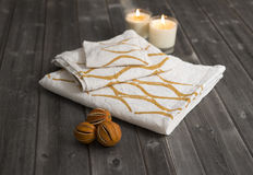 Towels with Orange Concave Lines Alongside Candles and Dried  Ci Stock Photography