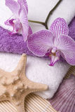 Towels and orchid Stock Photo