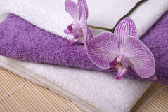 Towels and orchid Royalty Free Stock Photography