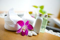 Towels and orchid with pebbles in spa Stock Image