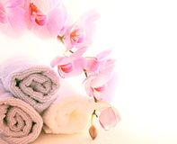 Towels and orchids Royalty Free Stock Image