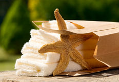 Towels with paper bag and sea star Royalty Free Stock Images