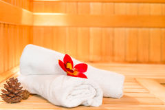 Towels and pine cones  in the sauna Royalty Free Stock Photo