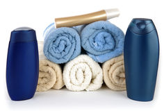 Towels and plastic bottle Stock Photos