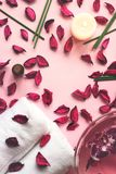 Towels, potpourri and scented sticks on pink background with cop. Y space for your text; wellness or spa background royalty free stock images