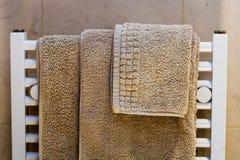 Towels on Radiator. Hotel style towels on radiator rack Stock Photo