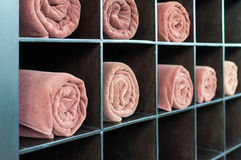 Towels roll on shelves Stock Images
