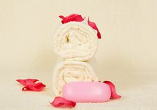 Towels roll, the soap, decorated with pink petals Royalty Free Stock Photography