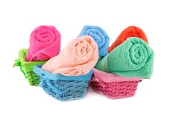 Towels. Rolled colorful towels in bamboo baskets isolated on white background Royalty Free Stock Photo