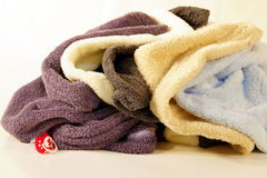 Towels rolled up into a ball. Clean towels waiting to be folded and Stock Photo