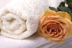 Towels and rose. Items for bath towels and beauty rose Royalty Free Stock Photos