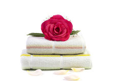 Towels with rose on top Stock Image