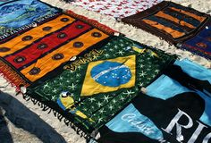 Towels in the sand. Ambulant commerce in sands of the beach of Ipanema Royalty Free Stock Photography