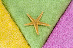 Towels and sea star Royalty Free Stock Photos