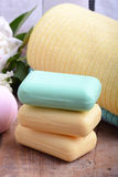 Towels set, aroma therapy, soap and sea salt on wooden plate Stock Photo