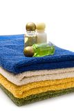 Towels and shampoo Stock Photos