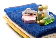 Towels, shampoo bottles Stock Image