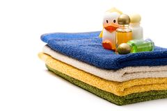 Towels and shampoo bottles Stock Images