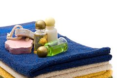 Towels and shampoo bottles Stock Photo