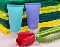 Towels, shampoo and flower Royalty Free Stock Image