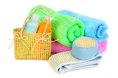 Towels and shampoo on white background Royalty Free Stock Photos