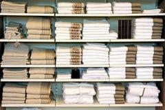 Towels shelf. Big pile of cotton towels at shelf stock photos
