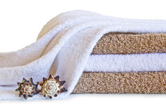 Towels with shells isolated on a white background. Image of towels with shells isolated on a white background Stock Photography